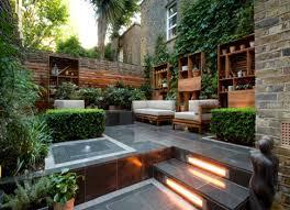 Unique modern backyard garden patio design idea with storage and plants