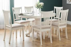julian bowen stamford ivory round extending dining table and chairs cfs uk
