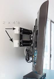 Pretentious Hiding Tv Cords Cable Box In And Swivel Tv Mount Together With  A Large Wall