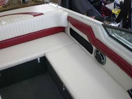 reupholstered red and white boat seats