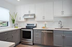 Grey and white kitchen design with stove and oven