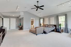 contemporary master bedroom with vaulted ceiling track lighting quorum estate 52 patio ceiling