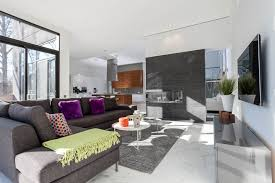 adorable grey colored sofas with chaise comes with round shape white coffee tables and purple velvet throw pillows