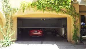 automatic retractable garage door screens