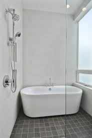 bathroom designs with freestanding tubs. Modren Freestanding Complete Your Charming Bathroom With Freestanding Tubs Ideas White  On Dark Floor Matched Wall And Faucet Shower Plus Frameless  In Designs A