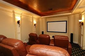 media room lighting. fully equipped media room with stepped seating the media room features sconce lighting surround sound stepped seating area and cove