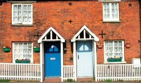 old red brick terraced homes with structural x ties