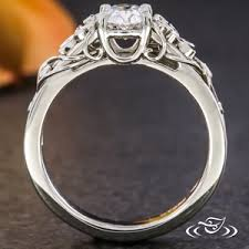 delicate end plumeria blooms frame an oval diamond in this fl enement ring hand crafted filigree dels create flowing vines and are accented