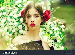 young beautiful woman with stylish makeup and red flower in hairstyle spanish on natural background ez canvas