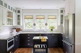 black lower cabinets with brass cup pulls transitional kitchen regard to white upper cabinet remodel 1