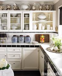 Top of cabinet decorating Decorative Craig Schumacher Laurel Bern Interiors The Tricks You Need To Know For Decorating Above Cabinets Laurel Home