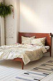 traditional tie dye comforter decor with wood beds and wooden floor for traditional bedroom