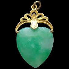wonderful green jade heart pendant with ornate 18 karat gold