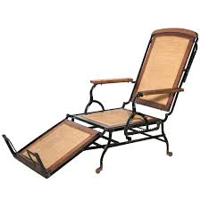 circa 1876 rolling walnut cane and black cast iron chaise lounge chair 1 folding patio chair