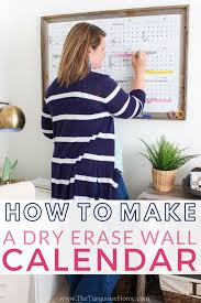 make your own diy dry erase calendar with a glass picture frame free yearly calendar printable and this super easy step by step tutorial