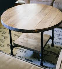 wood table with metal pipe legs brown industrial style reclaimed wood round coffee table with metal