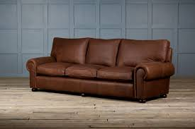 faux dark leather sofa bed with short wooden legs