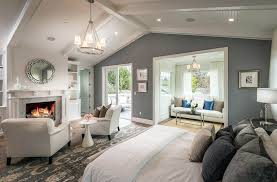 master bedroom with gray color paint fireplace and cathedral ceiling