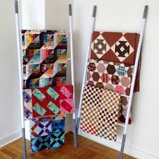 Display Your Quilts: 5 New Creative Ways & Here are some new and unique ways to display your quilts proudly! Adamdwight.com