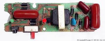 miniature electric fence circuit used in mosquito racket below an actual circuit board found in mosquito zapper rackets