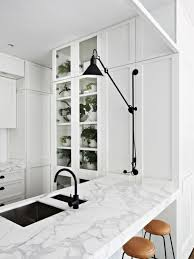 black kitchen faucet. modern black and white kitchen with leather stools, marble counters, fixtures faucet c