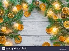 Christmas Branches With Lights Christmas Tree Branches With Lights On The Wooden Background