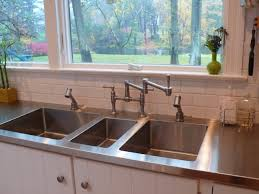 stainless steel counter counter top with three sinks