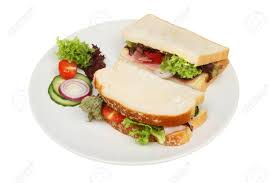 White Bread Ham Salad Sandwich On A Plate Isolated Against White