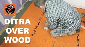 picture of install ditra on a wood suloor stop ed tiles