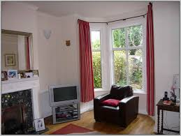 eyelet curtains on a bay window pole home design