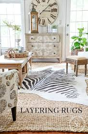 how to layer rugs layering rugs adds interest and texture and personal style to a
