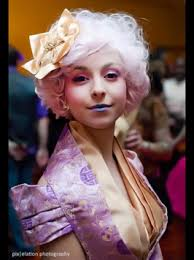 spazzyxremnant pulls off effie trinket makeup like a true capitol citizen pink wig and all