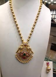 gold ball chain with peacock pendant