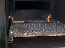 the firebox also has a heat shroud plate on that side to prevent radiant heat from hitting the hoses controls lp tanks