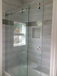 3 8 clear tempered glass with choice of polished or brushed stainless steel finishes this enclosure has one fixed panel and one sliding panel