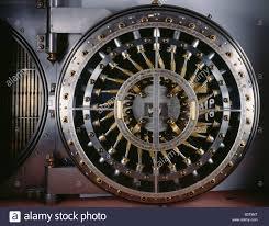 steel vault doors. Bank Vault Door, Featuring The Stainless Steel And Brass Locking Mechanism. - Stock Image Doors