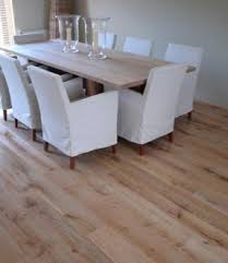 flooring for dining room. this distressed wood laminate flooring is stain-resistant and perfect for dining room
