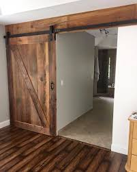 we love this gorgeous stained z barn door paired with the industrial s system the matching header really brings everything together
