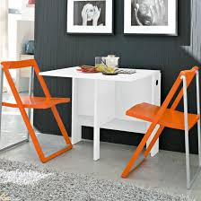 space saving furniture table. White Space Saving Table And Orange Folding Chairs Furniture
