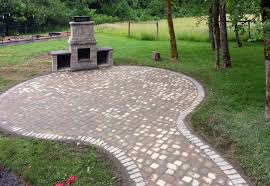 firepit with matching paver patio and connecting pathway