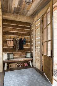 rustic cabin mudroom with bench