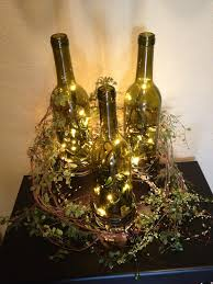 Lights For Wine Bottles 3 Wine Bottles Placed On Candle Holders Of Different Sizes