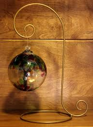 hanging height is 12 this stand is a great choice for our larger blown glass