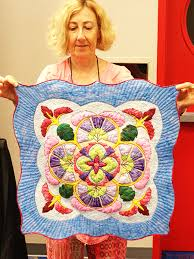 "International Quilt Festival in Houston Â« Karen Kay Buckley Blog & In the miniature category ""Tempest"" won third place. This quilt was made by  Kumiko Frydl. She is from Texas. I included the ribbon so you could see  just how ... Adamdwight.com"