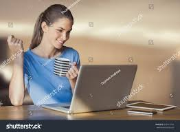 home office multitasking.  office home office multitasking beautiful young woman is multitasking seating  indoors at her holding for home office multitasking o