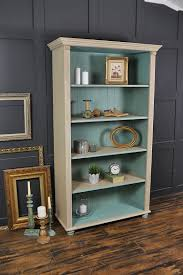 This farmhouse pine bookcase has been painted in Annie Sloan Country Grey  with a lightened version