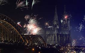 fireworks exploding over the rhine river during a new year s party in cologne germany