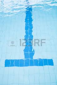 swimming pool lane lines background. Bottom Lane Line At End Of Swimming Pool With T-shape Slightly Distorted By Water Lines Background