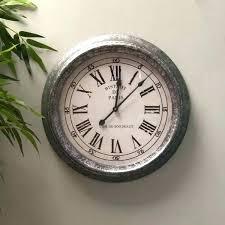 metal wall clock large bistro the hing clocks skeleton canada skeletal roman numerals