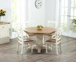 oak round pedestal extending dining table cream with extended chairs 1